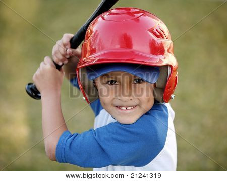 Portrait Of Boy With Baseball Bat And Red Helmet