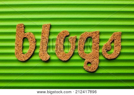 Word BLOG on green corrugated background