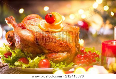 Christmas Chicken Dinner. Roasted Turkey. Winter Holiday table served, decorated with candles. Roasted chicken, Xmas table setting