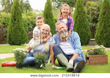 Elderly couple with grandchildren in garden