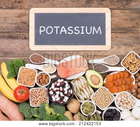 Food rich in potassium, top view with a small blackboard