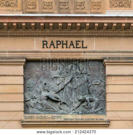 Sydney Australia - March 23 2017: Closeup of Bronze mural set in brown facade of Vernon building of Art Gallery of NSW shows Queen Hatasu of Egypt.