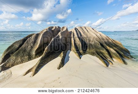 Beautifully shaped granite boulder in the sea shot in long exposure at Anse Source d'Argent beach, La Digue island, Seychelles