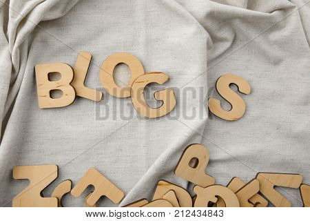 Word BLOGS on fabric background