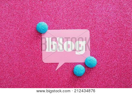 Dialog cloud with word BLOG and candies on color background