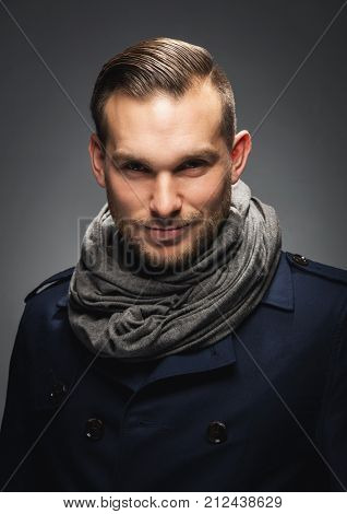 Handsome brunet man staring mysteriously at the camera. Confidence and attraction, studio portrait. poster