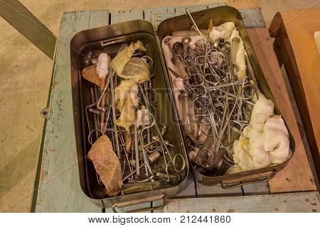 Old surgical instruments and tools in metal box