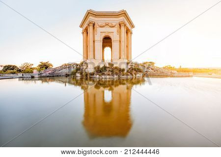 View on the water tower in Peyrou garden with beautiful water reflection during the evening light in Montpellier city in southern France