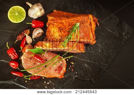 Raw pork chops with spices. Sliced meat prepared on the grill