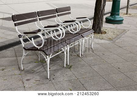 wooden bench for rest on the sidewalk