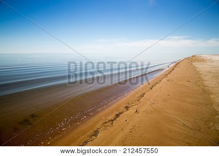 Sand coast of dying Aral sea in Kazakhstan at summer day. Ecologic catastrophe of Aral sea.