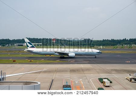 Cathay Pacific Airways On The Tarmac Of Narita Airport