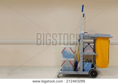 Cleaning Cart in the hospital with wall background and copy space.