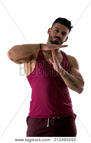 Fit shirtless muscle man gesturing time out sign with his hands isolated on white background
