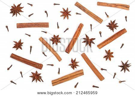 Composition of star anise, cinnamon sticks and clove isolated on white. Abstract pattern flat lay, top view.