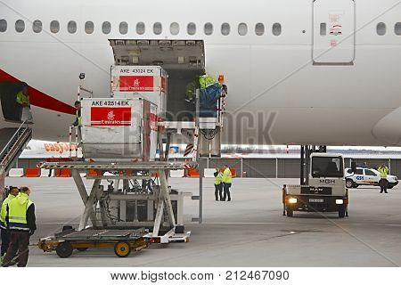 BUDAPEST, HUNGARY - DECEMBER 01, 2015: Emirates Boeing 777-300 being loaded with cargo containers at Budapest Airport.