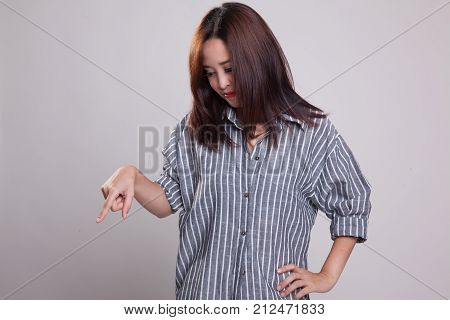 Beautiful Young Asian Woman Point Down To Blank Space.