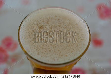 a new filled glass of beer frothy. drink ready to drink