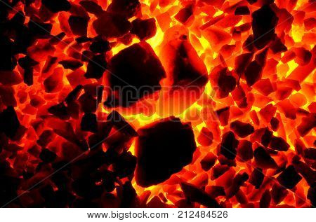Burning coal anthracite of coarse and fine fractions, as a background.