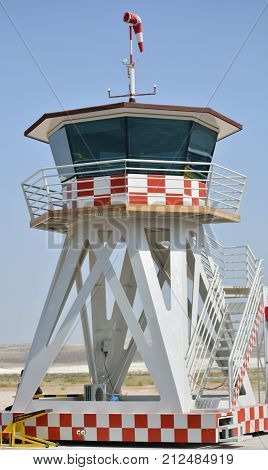 Air traffic control tower. Provide pilots with advice information and instructions via radio