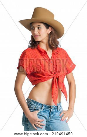 Pretty country girl wearing a cowboy hat. Isolated on the background.