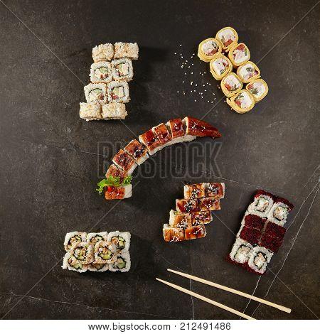 Asian menu. Set of rolls  - with eel, canada, bonito, burrito on black background