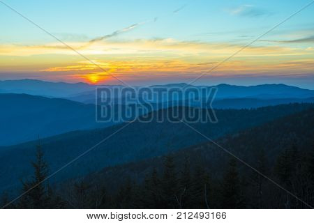 Spectacular Sunset in Smoky Mountains with Blue Ridge hills layered to the horizon with orange red sky