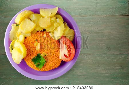 Meatball  With Potatoes On A Wooden Background