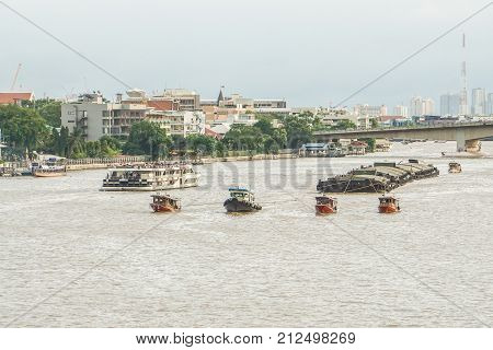 tugboat with loaded barge on Chaopraya river taken in Bangkok Thailand on 24 September 2017