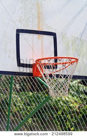 An Outdoor Basketball Backboard With Net Hoop
