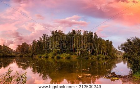 Beautiful Sunset over Lake with Reflection in Water