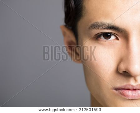 half face of Handsome young asian men
