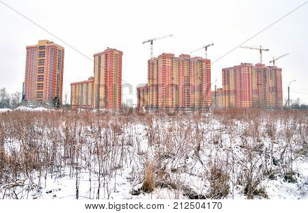 Houses under construction on the outskirts of St. Petersburg microdistrict Ribatskoe Russia.
