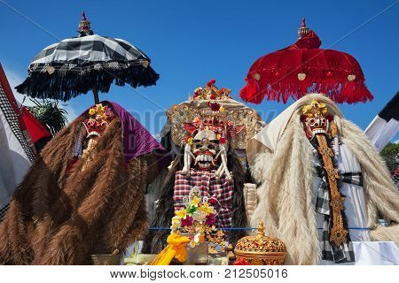 Traditional Barong and Rangda masks. Bali island spirit at ceremony Melasti and ritual temple dance before Balinese New Year silence day Nyepi. Holidays festivals art culture of Indonesian people.