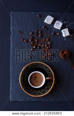 Turkish coffee and Turkish delight on a black background poster