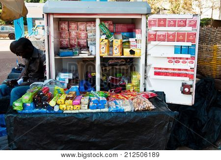 BAMAKO, MALI - CIRCA FEBRUARY 2012: Tobacco and snacks stand in a street of Bamako