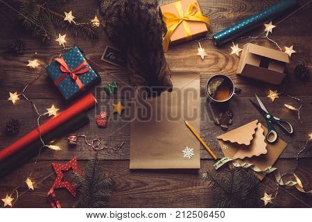 Beautiful Christmas Background With A New Year Décor, A Sheet Of Old Paper, Garland And Gifts, Cup O