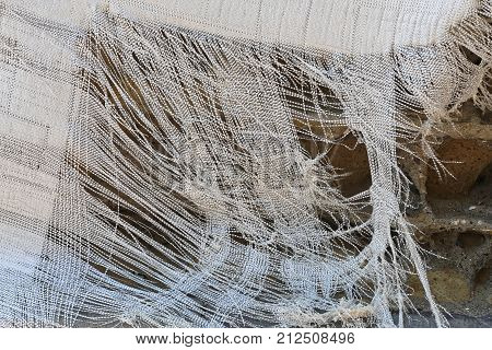Ragged Torn Plastic Sack Material Fabric Fibres