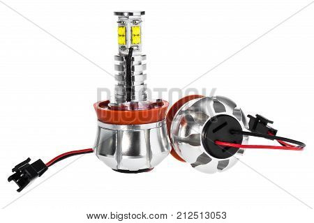 Light bulbs for car lamps. Car led for halo rings and angel eyes lighting effect. Automotive part in Silvery metallic and black color with wires and connecting elements on isolated white background. poster