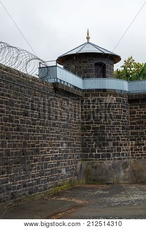 Old bluestone prison walls of the former Asylum for the Criminally Insane in Ararat, Australia.