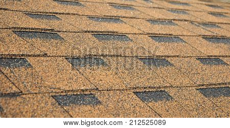 Panoramic View on Brown House Roof Asphalt Shingles Texture Background. Roof Shingles - Roofing Construction Roofing Repair.