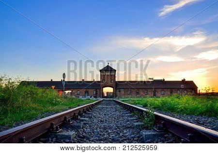OSWIECIM, POLAND - JULY 29, 2017: The main gate to the concentration camp Auschwitz Birkenau in Oswiecim, Poland.