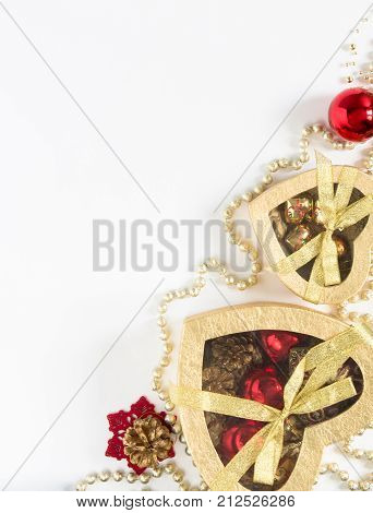 Christmas gift gold boxes on white background. Top view with copy space. Cristmas background. Red christmas balls