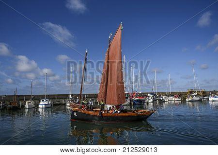 Varberg Sweden 1 August 2017: Old sailing yacht affecting the marina in Varberg Sweden