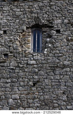 Old arched window in a stone building St David's cathedral Pembrokeshire Wales UK