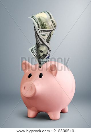 pink Piggy bank with dollar on grey