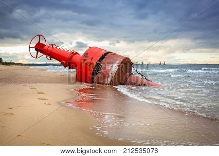 Sea mark buoy on the beach of Baltic sea after storm, Poland