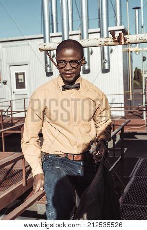 Young African American Man Sitting On Guardrails