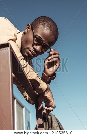 African American Man Leaning On Guardrails