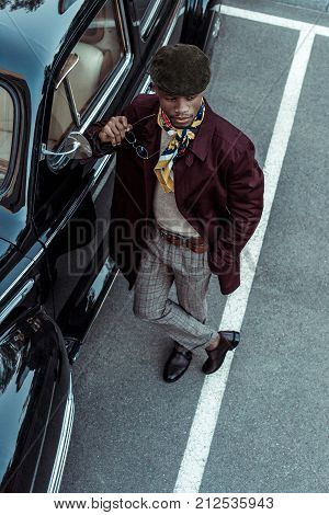 Fashionable Man Posing With Car